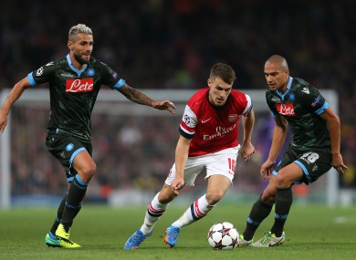 Aaron Ramsey goes by Gokhan Inler and Valon Behrami when Arsenal and Napoli met at the Emirates Stadium.