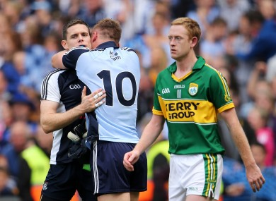 Kerry's Colm Cooper walks past Stephen Cluxton and Paul Flynn as they celebrate Dublin's win.