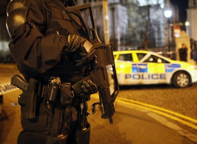 A PSNI officer close to the scene of the explosion in Belfast city centre last night