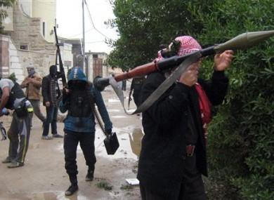 Gunmen patrol in Fallujah.