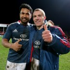 Casey Laulala and Keith Earls celebrate Munster's victory.<span class=