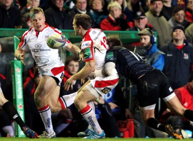 Darren Cave dishes the ball to Luke Marshall despite pressure from Toby Flood.
