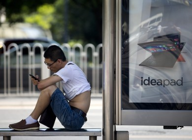A man checks his smartphone in Beijing.