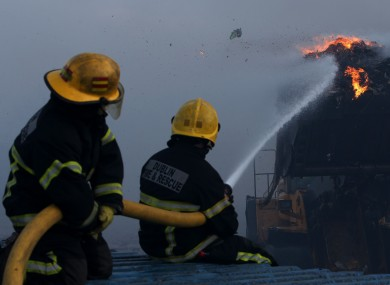 Firefighters fighting the blaze on Saturday morning.