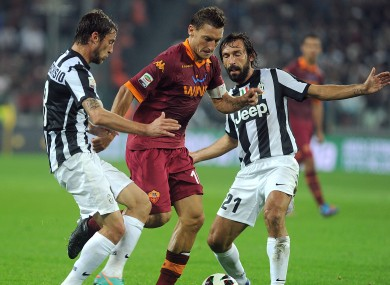 Francesco Totti is challenged by Claudio Marchisio and Andrea Pirlo last season.