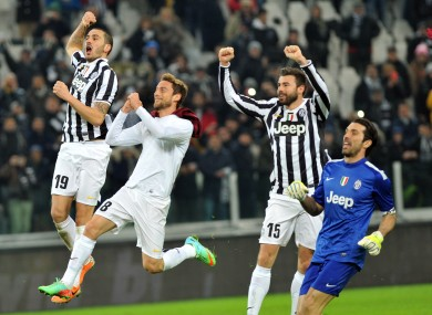Juve players celebrate after full time.