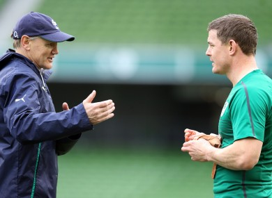 Ireland coach Joe Schmidt discusses tactics with Brian O'Driscoll.