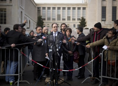 Journalists surround Monzer Akbik, spokesperson for the Syrian National Coalition, at the UN headquarters in Geneva, Switzerland.