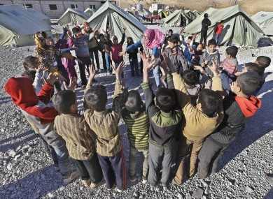Syrian children outside their tents at a refugee camp in the eastern Lebanese border town of Arsal.