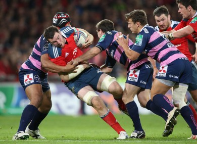 Peter O'Mahony is stopped in his tracks by three Gloucester players.
