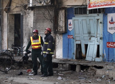 Rescuers at the site of the suicide bombing