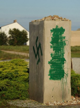 A Nazi swastika is seen in Jedwabne, Poland, on a monument dedicated to Jews.