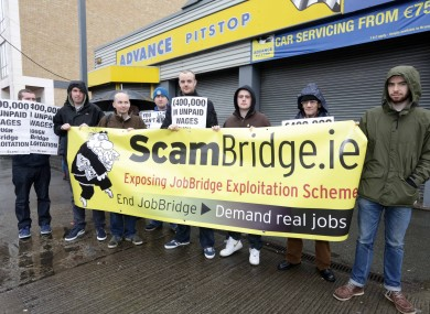 Members of the public and Socialist MEP Paul Murphy (far left) protest outside Advance Pitstop on Russell Street in Dublin