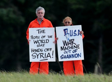 Shannon Peace activists Niall Farrell and Margaretta D'arcy as they attempt to block the runway of Shannon Airport in protest at the use of the airport by US Military and also against western intervention in Syria.