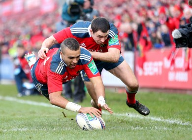 Simon Zebo beats Felix Jones to the ball but there is only place for one of the Munster men in our backline.