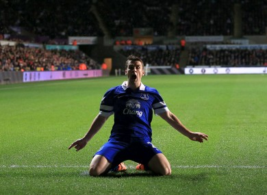 Everton's Seamus Coleman celebrates scoring his side's first goal.