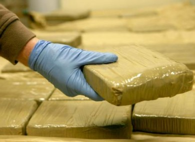 Garda handles seized heroin. (File photo)