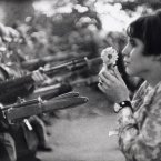 A Vietnam War protester brings a flower to soldiers in Washington D.C., on Oct. 21, 1967. Nearly 100,000 people came out to protest.<span class=