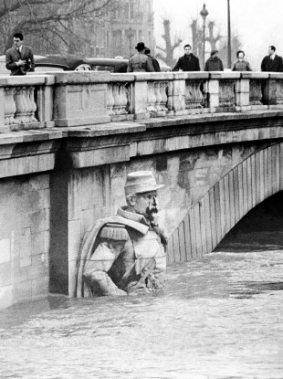 The figure of a Zouave half-submerged in January 1955 when the River Seine rose in Paris to dangerous levels/