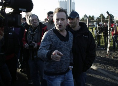 Mickael Wamen of the CGT union talks to the media after the two bosses left the plant.