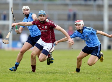 Conor Cooney of Galway battles with Dublin's Michael Carton and Cian O'Callaghan.