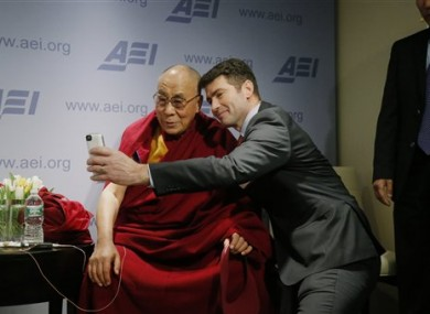 Tibetan spiritual leader the Dalai Lama poses for a
