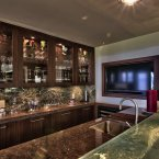 Mansouri's home also has the wiring capability for a professional DJ booth. This is a photo of her bar with mounted flatscreen television.