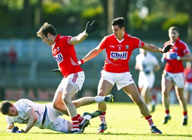 Cork's James Loughrey and Tomas Clancy with Kildare's Eoghan O'Flaherty.