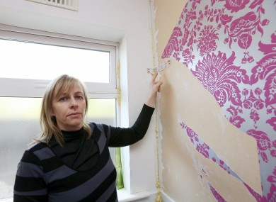 Suzanne Byrne of Dunshaughlin Co Meath demonstrates the damage caused to her home by pyrite.