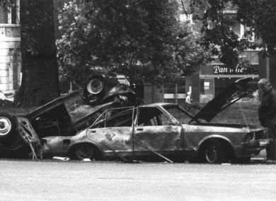 Remains of the car which housed the IRA Hyde Park car bomb in which killed four soldiers .