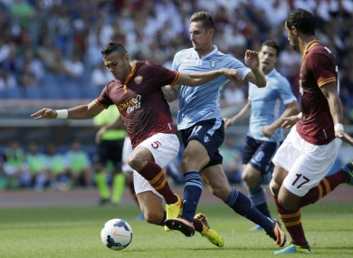 Roma defender Leandro Castan and Lazio striker Miroslav Klose.