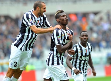 Paul Pogba celebrates scoring in last year's Turin derby.