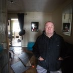 Kieran Hogan, shows the damage done by the floods to his home. <span class=