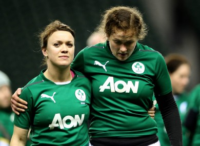 Cantwell [left] and Fiona Coghlan leave the Twickenham pitch after yesterday's defeat.