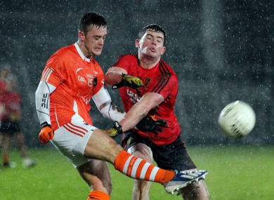 Armagh's Robbie Tasker in action with Down's Niall Madine.