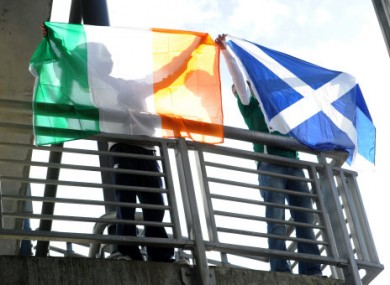Scotland and Ireland fans hold flags outside Murrayfield in 2011.