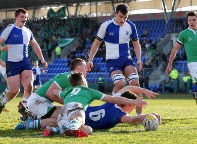 Andrews' Ryan Bradley scores his side's first try despite attention from Nick Peters and Paul Ryan of Gonzaga.