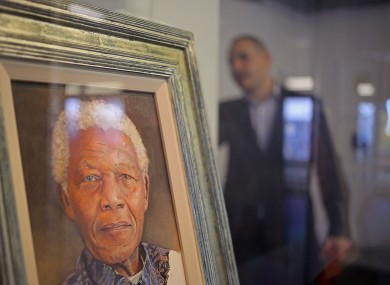 A painting of former South African president Nelson Mandela by British artist Richard Stone is displayed at a art exhibition in his honor at Cape Town.