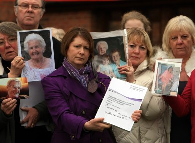 Relatives of patients involved in the Francis report hold pictures of their loved ones outside the Moat House hotel near Stafford, after Robert Francis QC delivered his report into failings at Stafford Hospital.