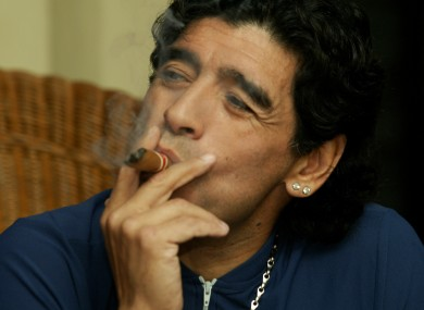 Former Argentine soccer player Diego Maradona speaks while he smokes a Cuban cigar with Javier Sotomayor (not in picture) in Havana, Cuba in 2005.