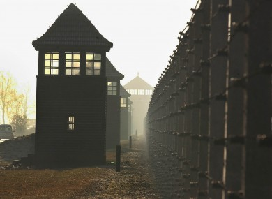 Watchtowers lining the fence in the former Nazi death camp Auschwitz.