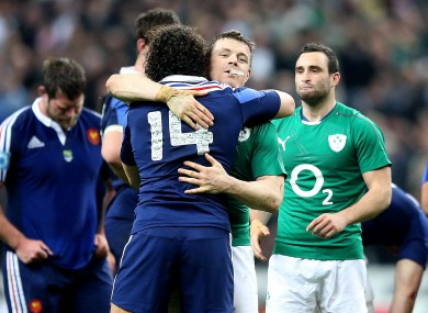 Yoann Huget hugs Brian O'Driscoll after France's 22-20 loss to Ireland.