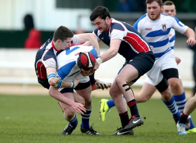 Daniel Layden and Matthew Cosgrove of Grammar tackle Garbally's Dylan Connolly.