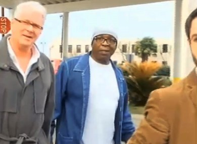 Glenn Ford, 64, (with white cap) walks out of prison on Tuesday.