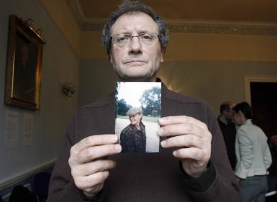 Jean-Pierre Gazeau holds a photograph of his niece, Sophie Toscan du Plantier.