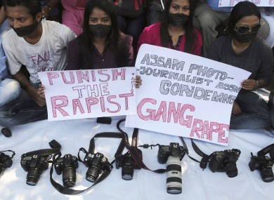 Photojournalists during a protest over the gang rape of the 22-year-old in Mumbai