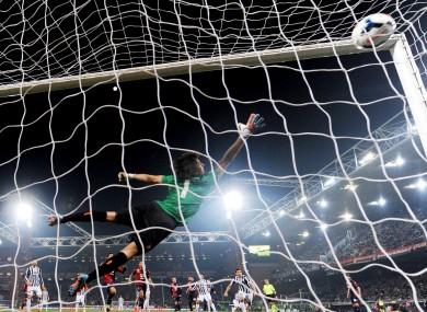 The Genoa goalkeeper fails to save Andrea Pirlo's free-kick.