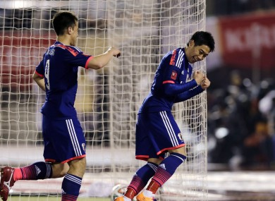 Japan's Shinji Kagawa, right, celebrates with teammates after scoring a goal.