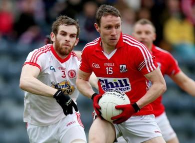 Cork's John Hayes and Tyrone's Ronan McNamee.