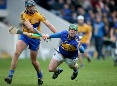 Tipperary's John O'Dwyer and Brendan Bulger of Clare.
